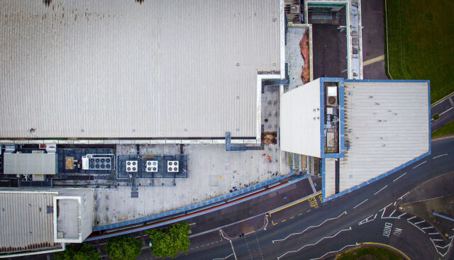 aerial photo looking down onto commercial roof top where drone survey is taking place
